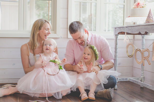 Toddler Birthday Party Ideas: Family Photography in tulle dresses. Pink theme tea party.