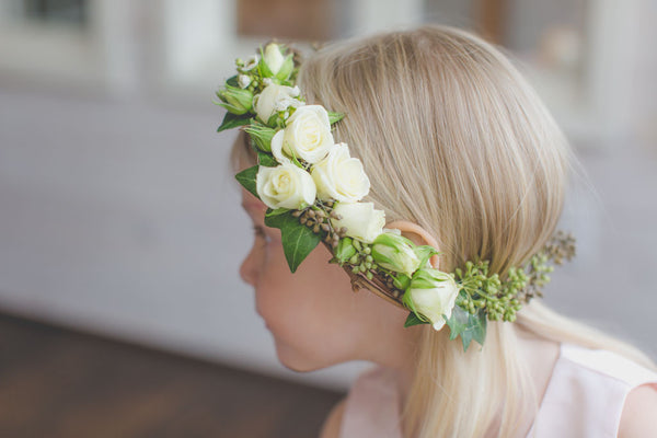 Flower girl handmade flower crown with white roses and greenery. Wedding or party style ideas.