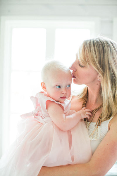 Mom and baby natural light photography. Light pink tulle baby dress. Birthday photo session.