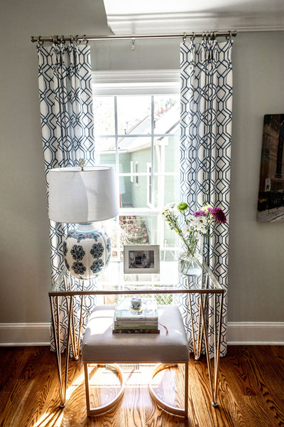 Blue Patterned Drapery, Accent Table in Front of Window