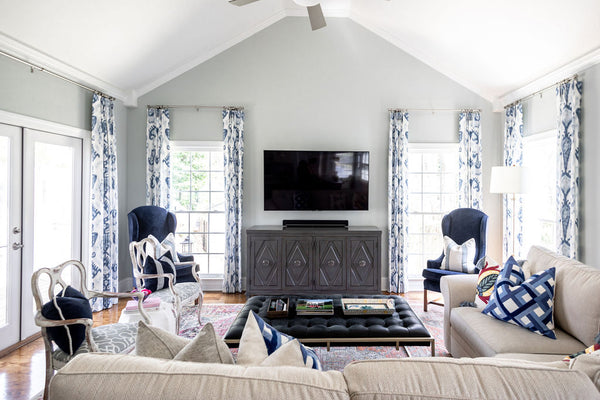 Light filled blue accent neutral living room addition