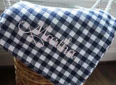The Millie Forever Blanket in gingham check fabric for everyday. Personaliezed and Monogrammable. Baby Blanket. Heirloom. Soft and beautiful. Support Adoption. Classic gingham check baby blanket in pink, green, navy and blue. Navy baby nursery.