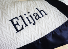 The Gabriel Forever Blanket by Swell Forever in multiple satin trim colors. Heirloom baby blanket with personalized, sentimental message tags. Monogramming available.