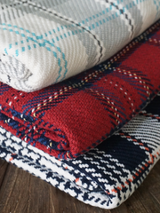 The Kevin Forever Blanket {throw} by Swell Forever in plaid cotton. American Made heirloom blankets with unique personalized message tags. Red plaid, khaki, and teal color options. Your purchase supports adoption. Romantic gifts for men. Anniversary, wedding, engagement, father's day gift ideas.