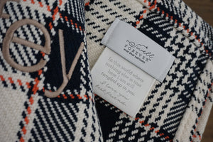 The Kevin Forever Blanket {throw} by Swell Forever in plaid cotton. American Made heirloom blankets with unique personalized message tags. Red plaid, khaki, and teal color options. Your purchase supports adoption. Romantic gifts for men. Anniversary, wedding, engagement, father's day gift ideas. Perfect anniversary gift. Cotton.