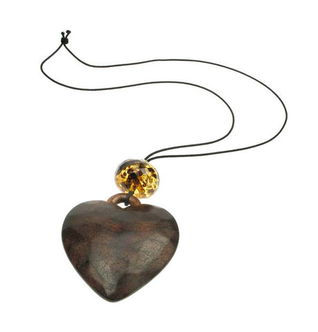 Heart pendant with faceted tortoise bead