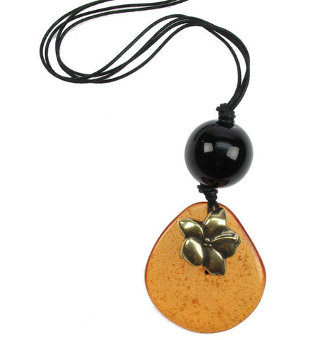 Transparent amber pebble and black bead pendant with gold flower