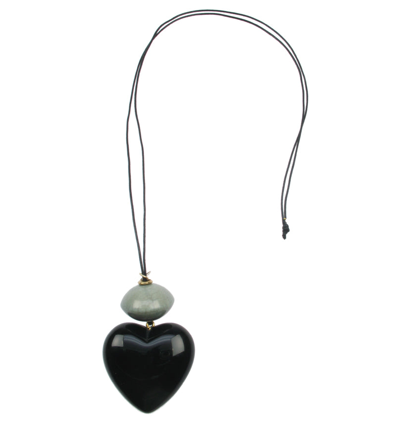 Black heart pendant with cracked jade bead.