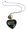 Black heart pendant with smoked yellow bead.