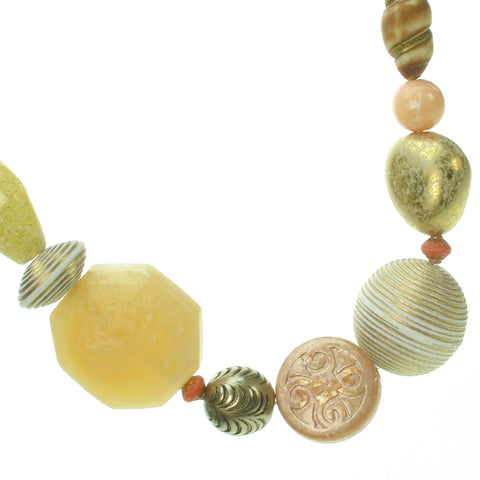A subtle mixture of ivory, antique gold and coral bead necklace