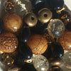 A blend of black, antique gold and tortoise bead necklace
