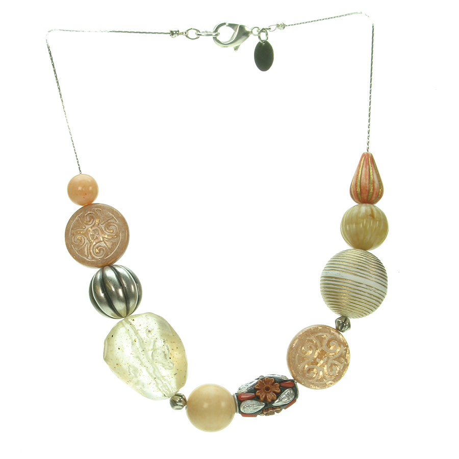 A subtle mixture of ivory, antique silver and coral bead necklace