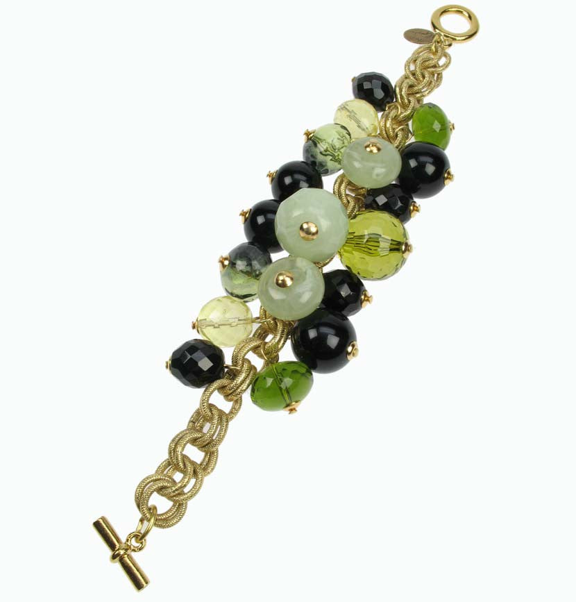 Green charm bracelet on gold coloured chain