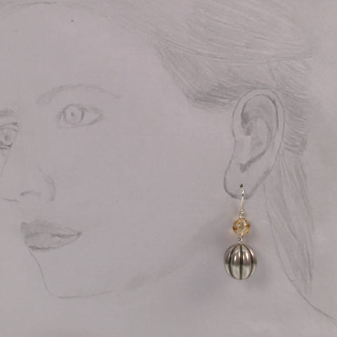 Antique silver plated decorative earrings with tortoise bead