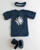 blue sweater with snowflake boots and headband