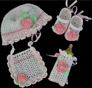 baby girl set with pink hat booties bib and bottle holder