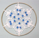 white and blue beaded sun catcher