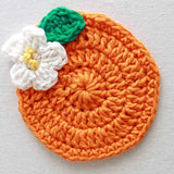 orange and white flower coaster