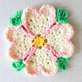 pink and white flower coaster