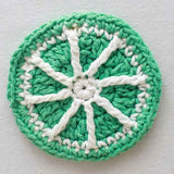 green and white pinwheel coaster