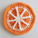 orange and white pinwheel coaster