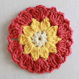 red and yellow flower coaster
