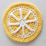 yellow and white pinwheel coaster