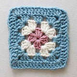 blue, white, and purple flower coaster
