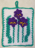 Violet flowers potholder