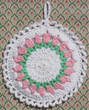pink and green flower potholder