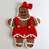 gingerbread lady with red dress and bow