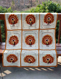 white and orange turkey afghan