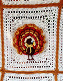 white and orange turkey afghan close up