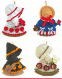 various broom dolls