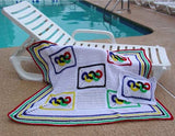 white olympic rings and pillow