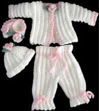 pink and white baby outfit