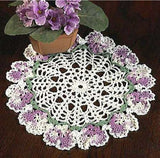 white and purple flower doily