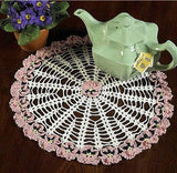 pink and white flower doily