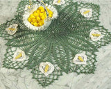 green and white flower doily