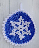 blue and white snowflake potholder