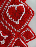red afghan with white hearts