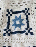 white and blue afghan
