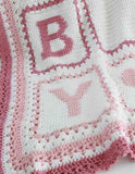 pink and white B and Y afghan blocks