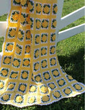 yellow afghan with yellow flowers