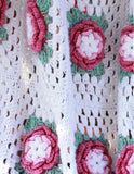 white afghan with pink flowers