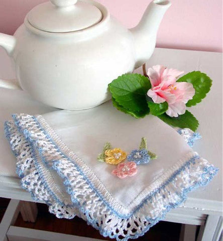 white rose handkerchief with blue edging