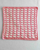 pink and white washcloth
