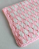 pink and white rug