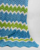 blue green and white baby afghan