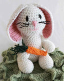 white bunny rabbit with carrot